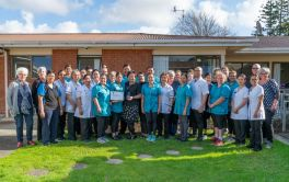 Aged Care Full staff photo with People's Choice award