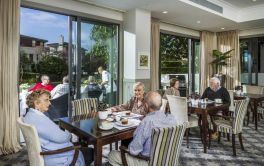 Retirement Village Residents enjoying tea & coffee at the cafe with outdoor terrace
